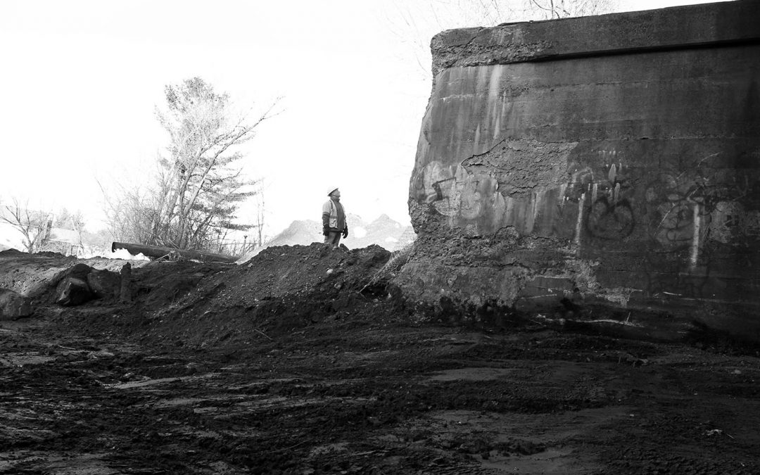 Black and white image of construction engineer at the Tel-Electric Dam in Pittsfield, Massachusetts
